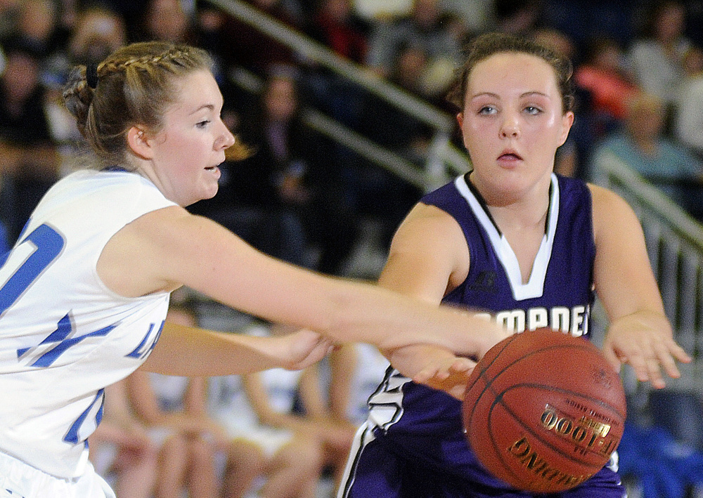 Lawrence's Camryn Caldwell guards Hampden's Braylee Wildman during a Class A North semifinal at the Augusta Civic Center.