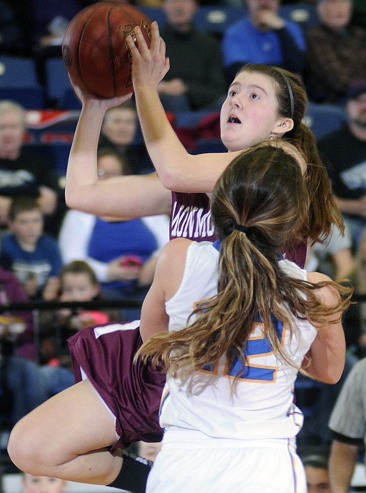Monmouth's Abbey Allen gos up for a basket over Boothbay's Kate Friant during a Class C South semifinal Thursday afternoon at the Augusta Civic Center.