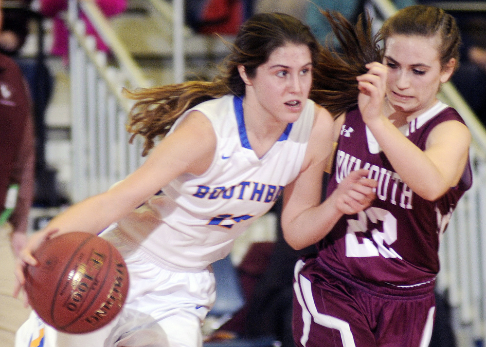 Monmouth Academy's Sidney Wilson, right, keeps the pressure on Boothbay's Kate Friant during a Class C South semifinal Thursday at the Augusta Civic Center.