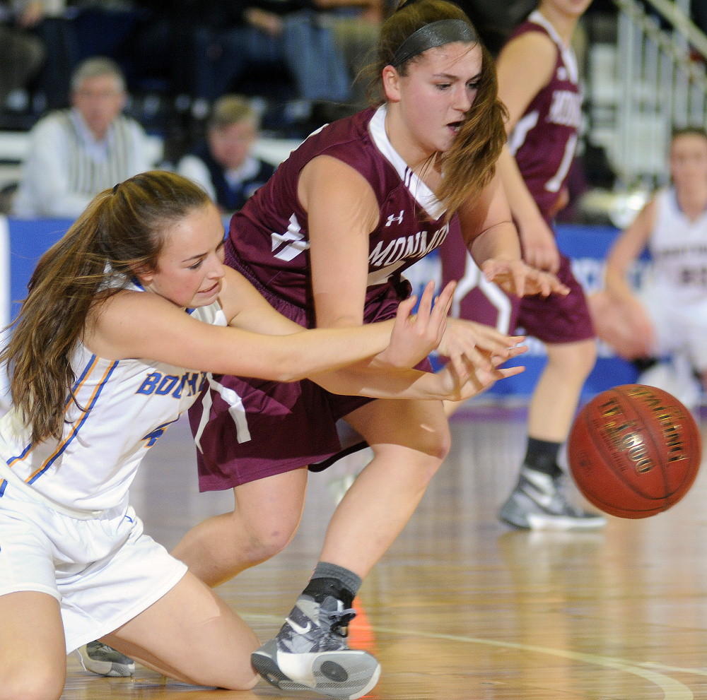 Monmouth Academy's Haley West, right, dives for the ball with Boothbay's Hannah Morley during a Class C South semifinal Thursday afternoon at the Augusta Civic Center.