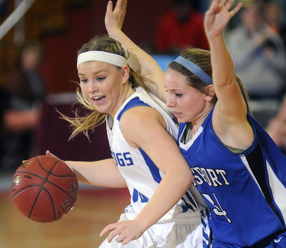 Madison Area Memorial High School's Madeline Wood, left, maneuvers around Searsport District High School's Karigen Coffin during a Class C South semifinal game Thursday in Augusta.