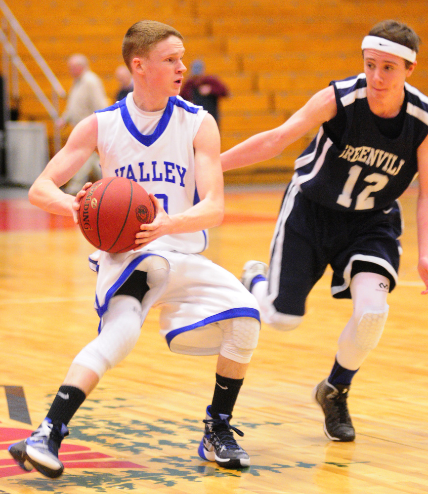 Valley's Luke Malloy, left, looks to pass against Greenville's Noah Pratt during a Class D South semifinal game Wednesday at the Augusta Civic Center.