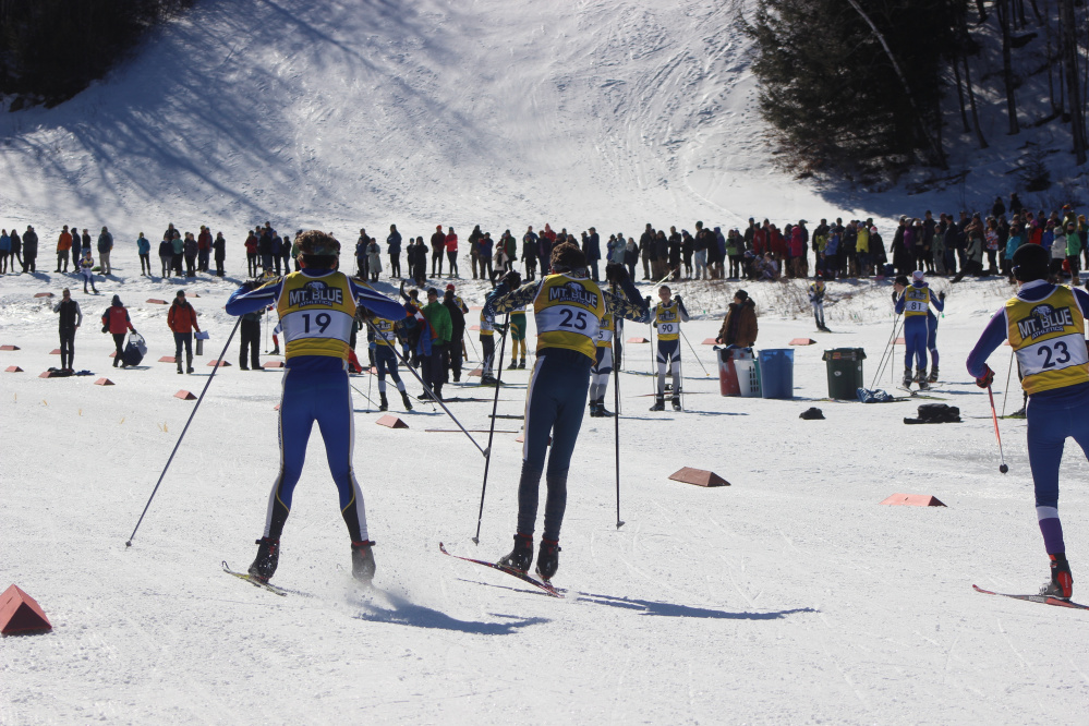 Mt. Blue Nordic skier Tucker Barber (25) heads to the finish line of the freestyle 5-kilometer race Friday at Titcomb Mountain. Barber finished second.