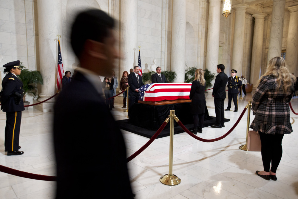 Members of the public attend a visitation in the Great Hall of the Supreme Court where Supreme Court Justice Antonin Scalia lies in repose in Washington on Friday.