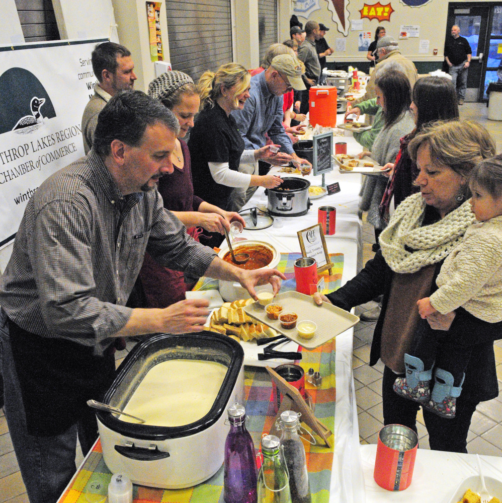 Patrons go through the line during the chili, chowder and soup fundraiser event on Saturday at Winthrop High School.