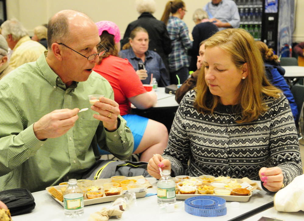 Mark and Lillian Lake, of Wilton, discuss how they like their many samples during the chili and chowder fundraiser event on Saturday at Winthrop High School.