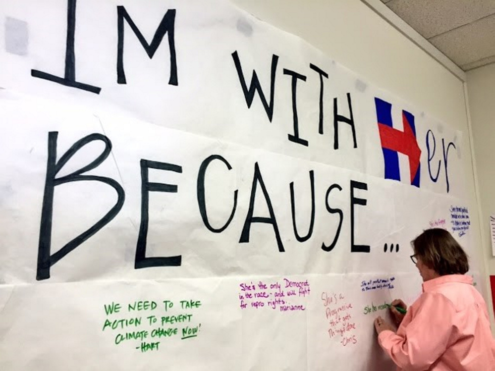 Hillary Clinton supporters gathered in Augusta Sunday to celebrate the opening of a new campaign office.