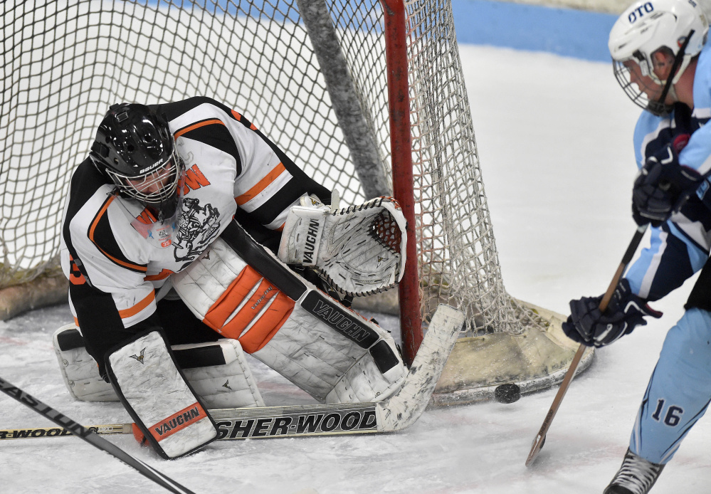 Winslow goalie Andrew Beals makes a save during a Class B North game against Old Town/Orono earlier this season at Sukee Arena. Beals and the Black Raiders open the playoffs Tuesday against Brewer in a Class B North quarterfinal.