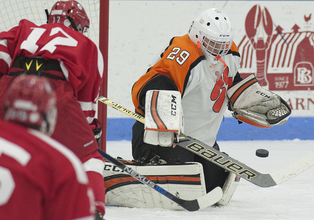 Gardiner goalie Michael Poirier makes a save during a game against Cony earlier this season at the Ice Vault in Hallowell. Poirier and Tigers open the B South payoffs Tuesday night against Gorham.