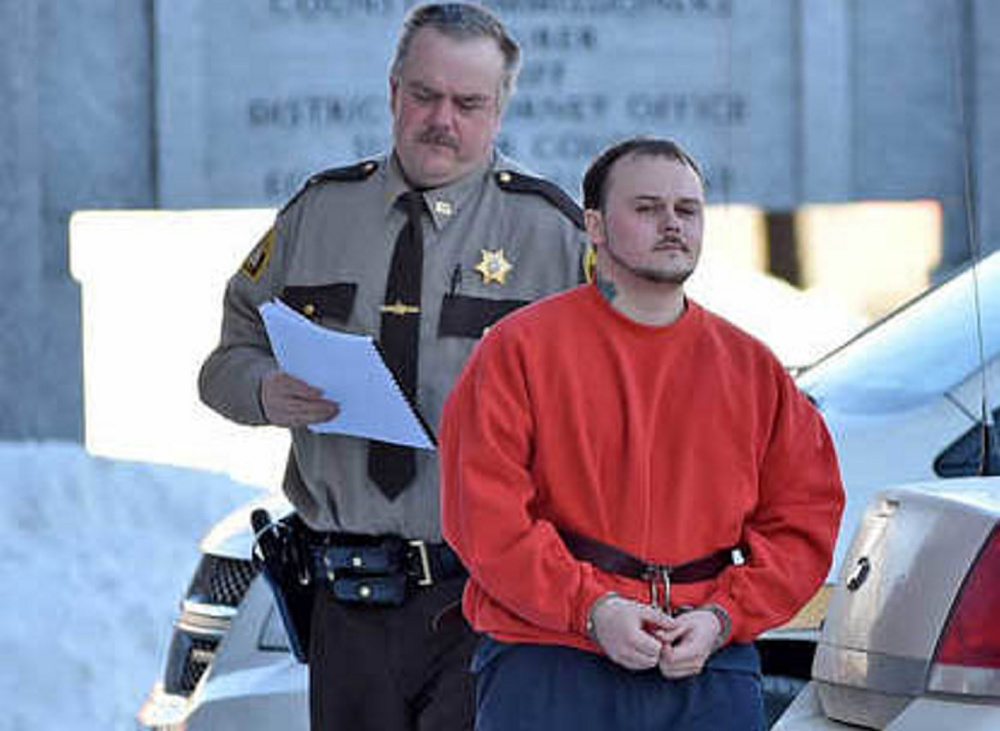 Staff file photo by Michael G. Seamans Jason Cote, 25, of Palmyra, is escorted into Somerset County Superior Court Feb. 12 for his sentencing hearing for the murder of Ricky Cole,of Detroit. Cote lawyer, Stephen Smith, has appealed Cote's December murder conviction and his prison sentence of 45 years, saying the state did not prove murder and that Cote acted in self defense.