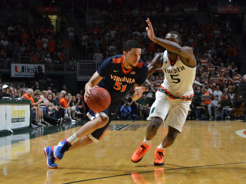 AP photo   Virginia's Darius Thompson attempts to get by Miami guard Davon Reed during the second half of a game Monday in Coral Gables, Florida.