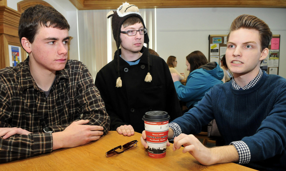 Members of the comedy improv group The Lawn Chair Pirates discuss their craft on Monday at the University of Maine at Farmington. From left are Nick Minor, Jagger Trouant and Aaron Verrill.