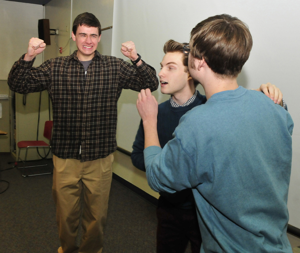 Nick Minor, Aaron Verrill and Jagger Trouant, University of Maine at Farmington students and members of an improv comedy troupe, The Lawn Chair Pirates, clown around in the Roberts Union on Monday.
