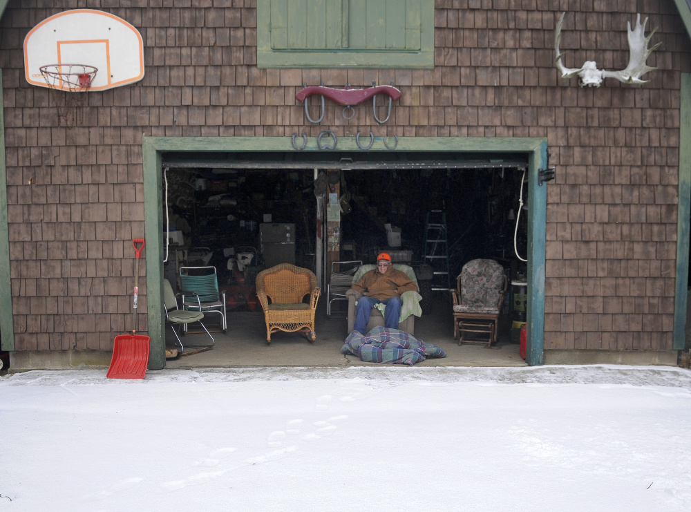 "Ernie McPherson takes to the recliner Wednesday after cutting a path to his Farmingdale garage with a shovel. ""The hell with it,"" the 88-year-old said of the quarter inch of fresh snow. ""I'll let it melt."""
