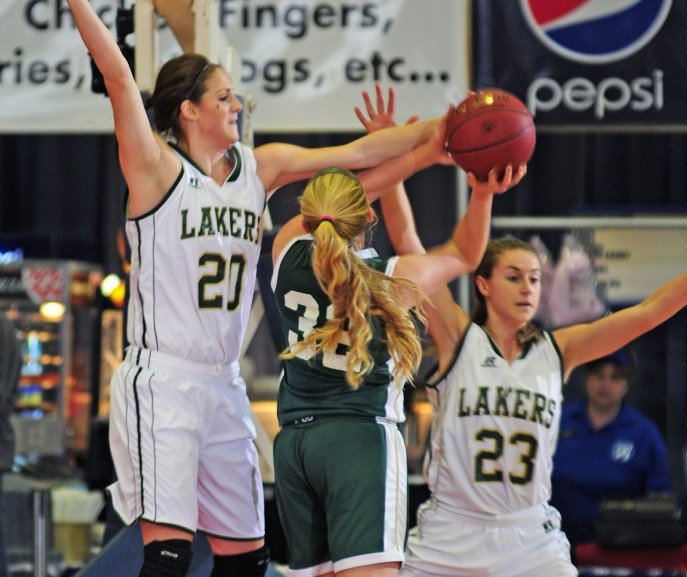 Temple Academy's Olivia Baker, right, tries to shoot under defensive pressure from Rangleley's Blayke Morin (20) during a Class D South semifinal game last Thursday at Augusta Civic Center.