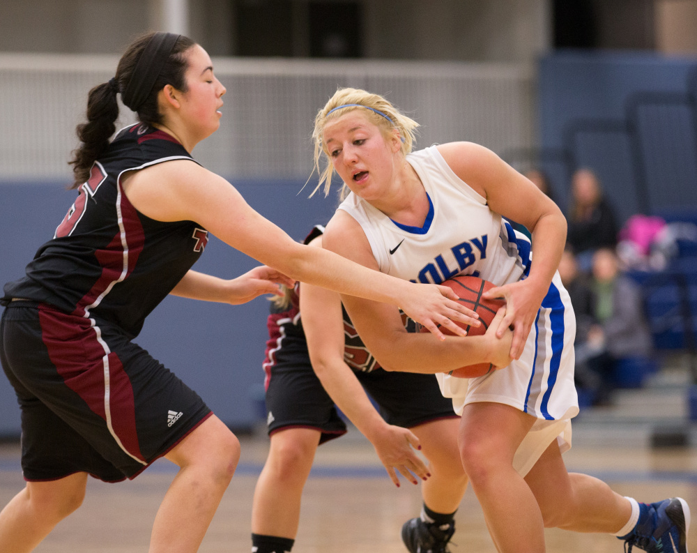 Colby College's Carylanne Wolfington, of Hallowell, protects the basll in a game against the Massuchesetts Institute of Technology on November 22, 2014 in Waterville, ME.