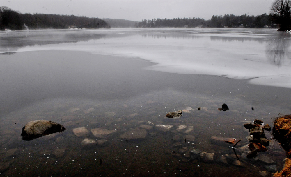 Open water and ice meet at the outlet to Messalonskee Lake in Oakland on Thursday. The Friends of Messalonskee group has canceled the March 6 fishing derby because of unsafe ice conditions.