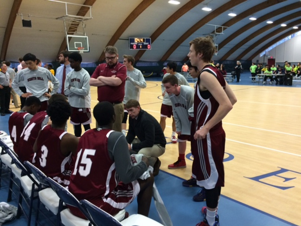 The Kents Hill boys basketball team huddles up during a game against Hyde School earlier this season.