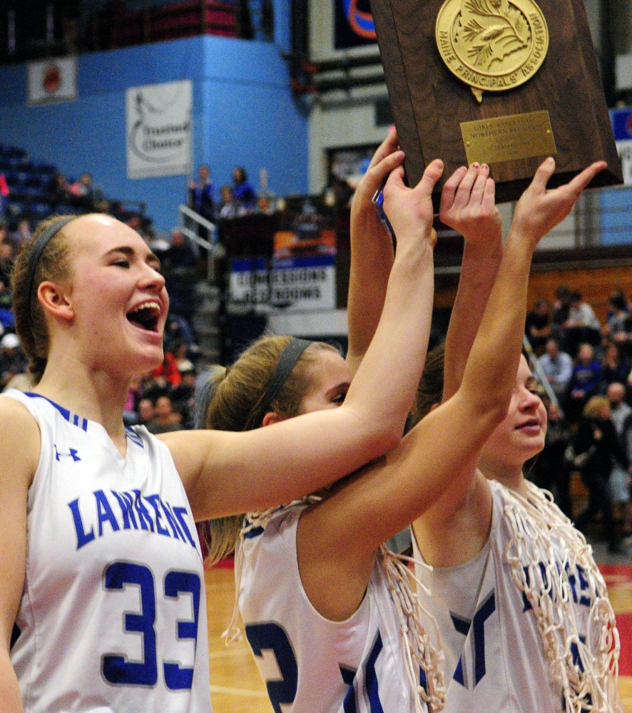 Lawrence captains Nia Irving, left, Dominique Lewis and Morgan Boudreau hold the Class A North championship plaque last Friday at the Augusta Civic Center.