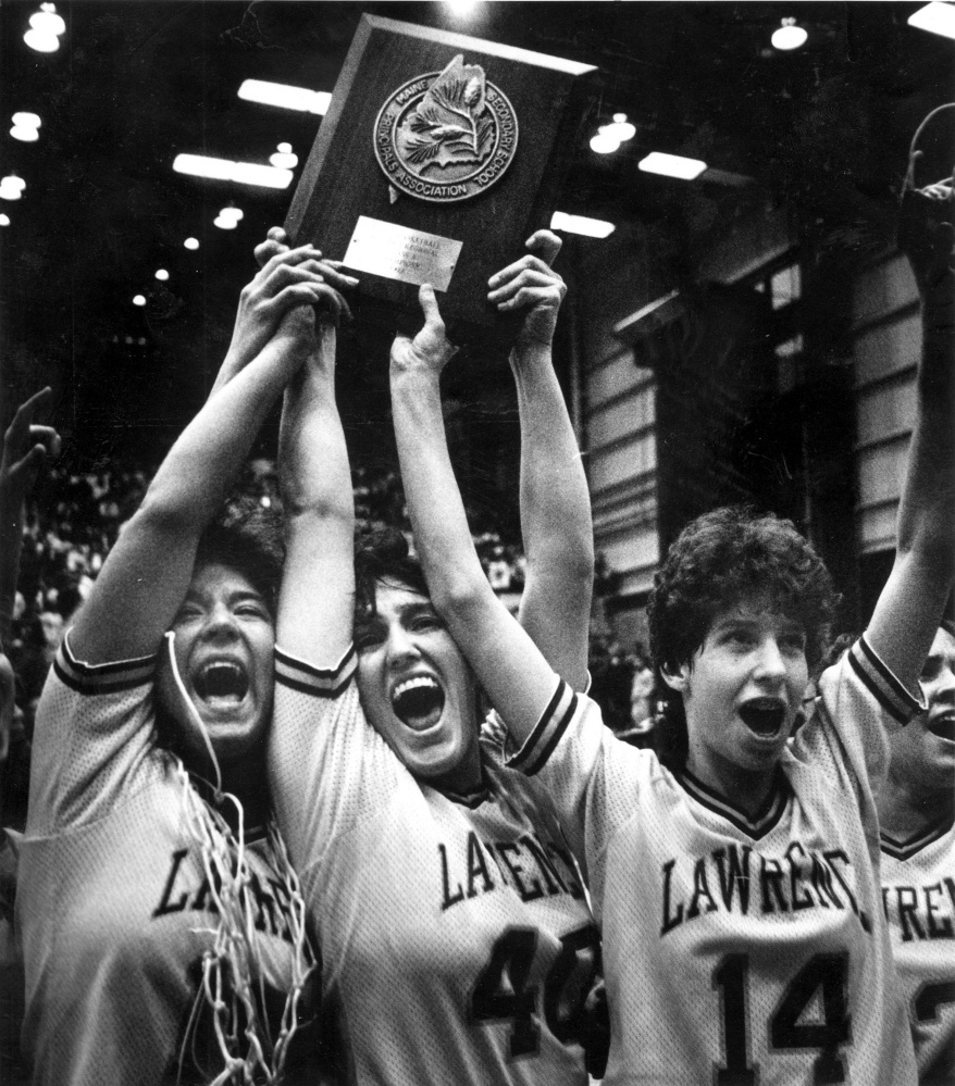Cindy Blodgett, far right, with Lawrence High School teammates Taffy Witham, left, and Marsha Hamlin, center, celebrate their Eastern A championship over Stearns, 64-49, in the Bangor Auditorium in March 1992.
