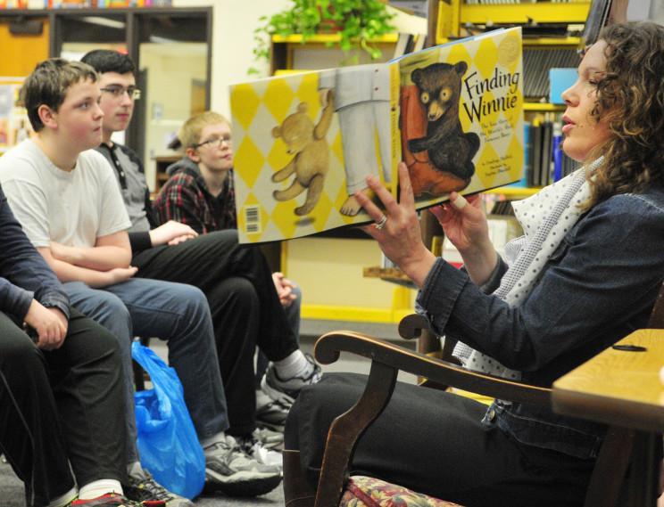 Stacy Caron, community business development manager at the Augusta Barnes and Noble, reads to students on Friday at Gardiner Regional Middle School.