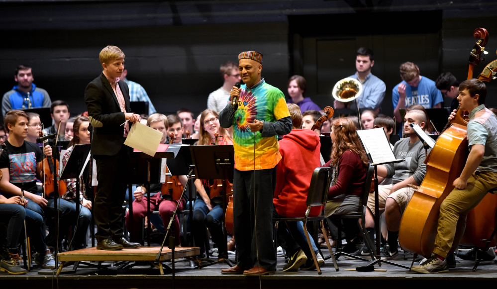 Srinivas Krishnan, master percussionist who created and produces Global Rhythms World Music, is introduced by strings conductor, Sam Lyons, during a concert  at Waterville Senior High School on Friday. Krishnan spent the week with Waterville students, teaching them about music of other cultures. They performed with Colby College musicians and community musicians mid-week.