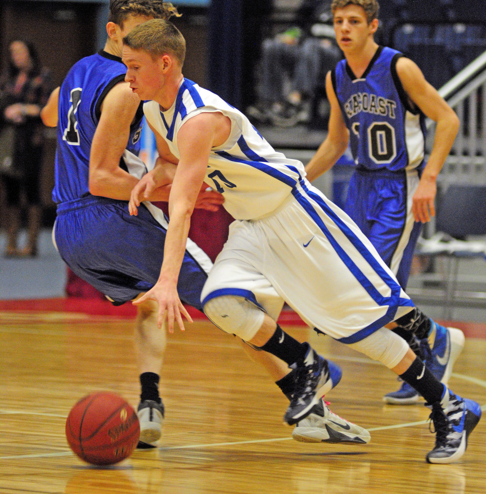 Valley's Luke Malloy drives to the hoop during the Class D South championship game Saturday at the Augusta Civic Center.