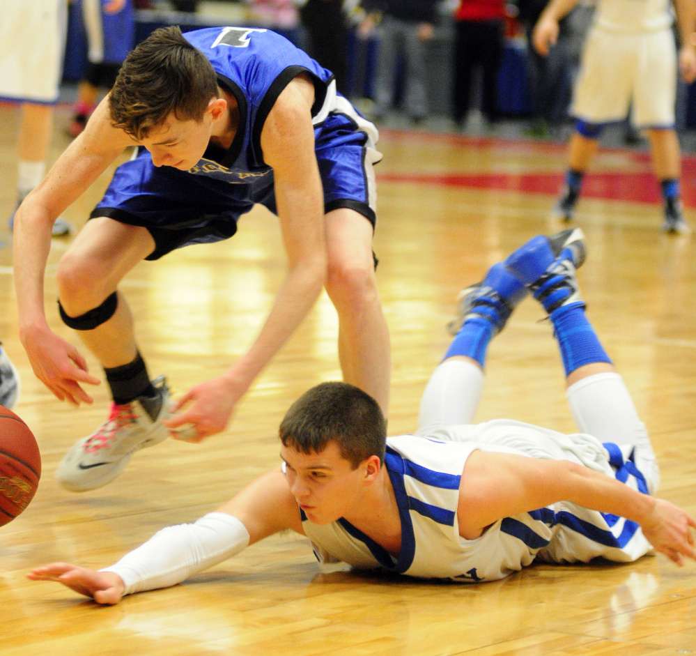Seacoast Christian's Jet Archer, left, and Valley's Dillon Beane scramble after a loose ball during the Class D South championship game Saturday at the Augusta Civic Center. Beane and the Cavaliers will play Easton for the Gold Ball on Saturday in Augusta.