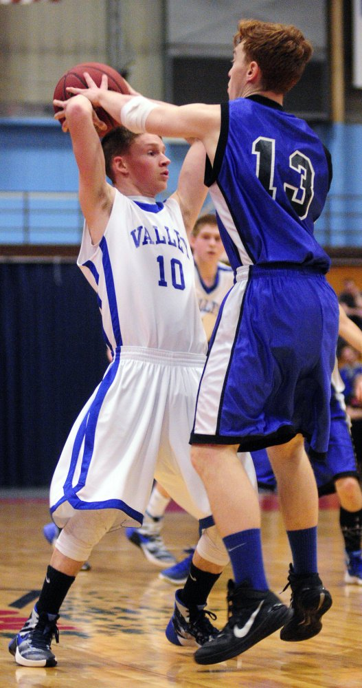 Valley's Luke Malloy, left, gets fouled by Seacoast Christian's Sky Archer late in the Class D South championship game Saturday at the Augusta Civic Center.