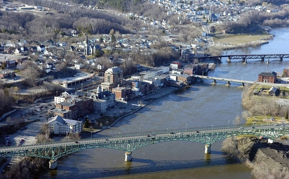 This April 2007 aerial photo shows the Kennebec River in Augusta. The Memorial Bridge runs across the bottom, then the Calumet Bridge at Old Fort Western and then a railroad bridge.
