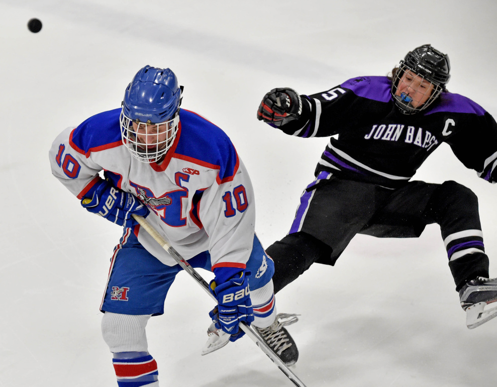Messalonskee forward Brandon Nale gets past John Bapst's Tyler Wheeler during the first period of a Class B North quarterfinals Tuesday at Sukee Arena in Winslow.
