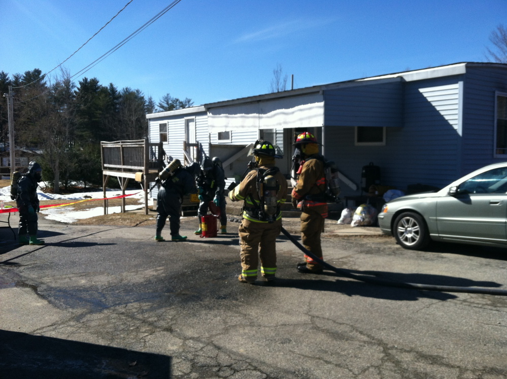 Authorities wearing hazmat suits search a Livermore Falls home Saturday after raiding an alleged meth operation.