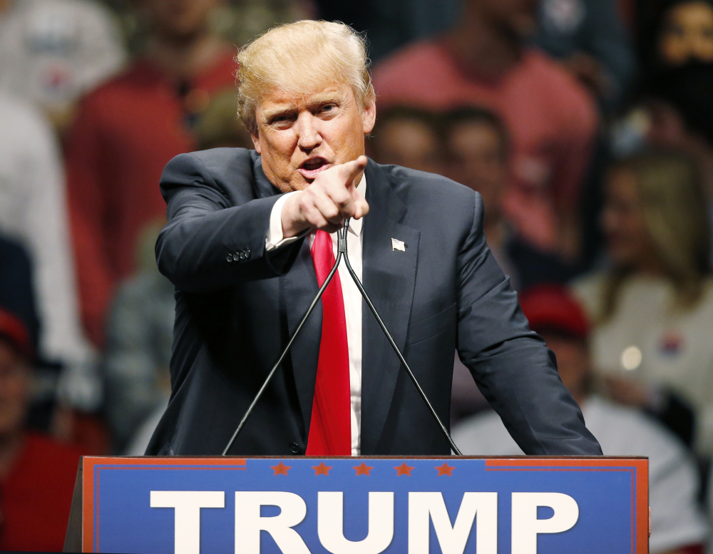 Republican presidential candidate Donald Trump gestures during a speech to a rally in Oklahoma City, Friday.