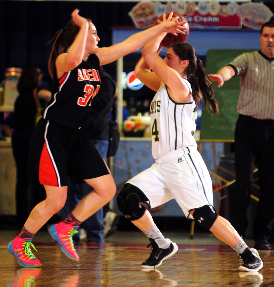 Staff photo by Joe Phelan   Shead's Katelyn Mitchell, left, defends Rangeley's Sydney Royce during the Class D state championship game Saturday at theAugusta Civic Center.
