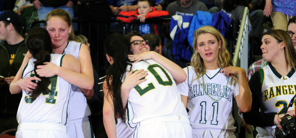 Rangeley players — past and present — celebrate after the Lakers won the Class D state title Saturday afternoon at the Augusta Civic Center.