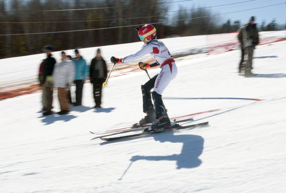 Kents Hill School student Matt Wall zooms down the course during a slalom ski racing fundraiser and food drive Saturday at the school in Readfield.