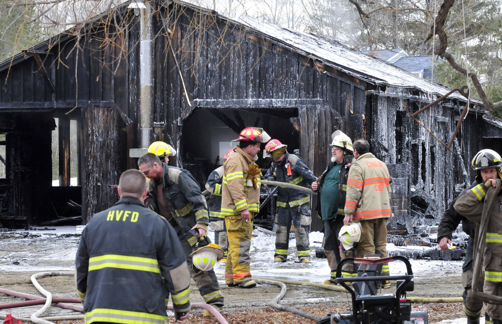 Firefighters from several departments put out the fire that destroyed a garage and tools at a home on the Huff Hill Road in Hartland on Sunday.