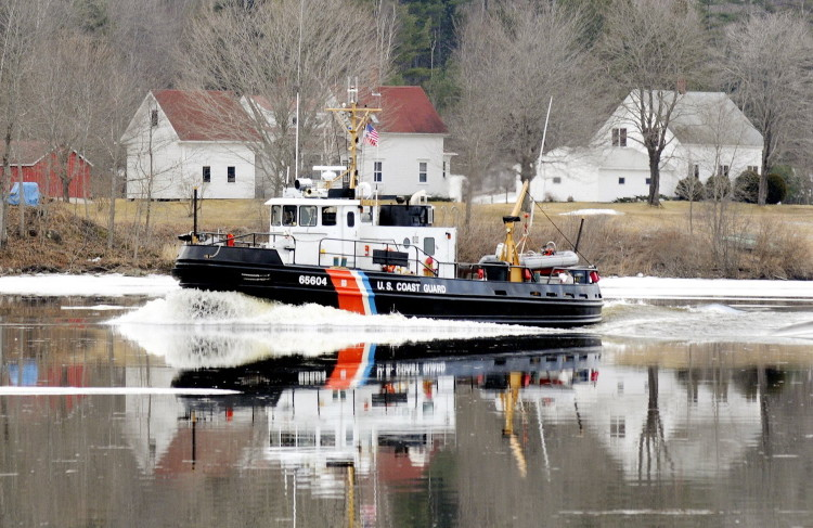 A Coast Guard ice cutter cruises up the Kennebec River past the Moulton Farm in Pittston in this 2012 file photo.