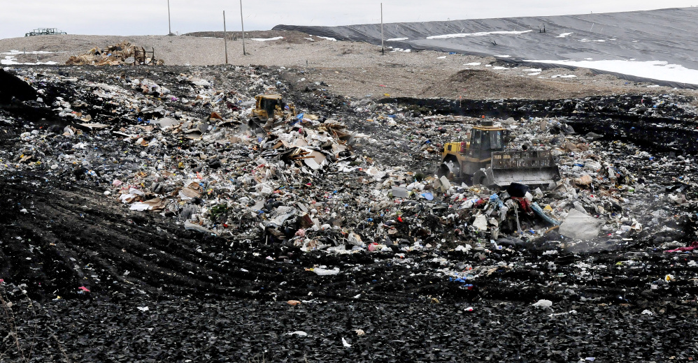 Two large bulldozers move a small mountain of trash at the Waste Management landfill in Norridgewock on Monday. Fairfield officials are moving forward with plan to contract with Waste Management to take the town's solid waste after 2018, when its contract with Penobscot Energy Recovery Company in Orrington expires.
