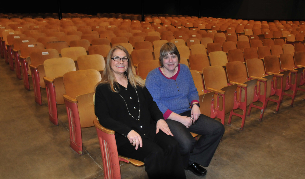 On Monday, Waterville Senior High School Drama Director Gayle Giguere, left, and Band Director Sue Barre sit on some of the 700 seats in Trask Auditorium that will be replaced. There will be a Save A Seat kickoff celebration March 10 at the school in hopes of raising $150,000 for new seats.