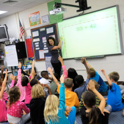 Third-grade teacher Melissa Grieshober teaches a math lesson at Silver Lake Elementary School in Middletown, Del., in 2013. Scientists have put youngsters into brain scanners to watch how the brain reorganizes itself as kids learn math.