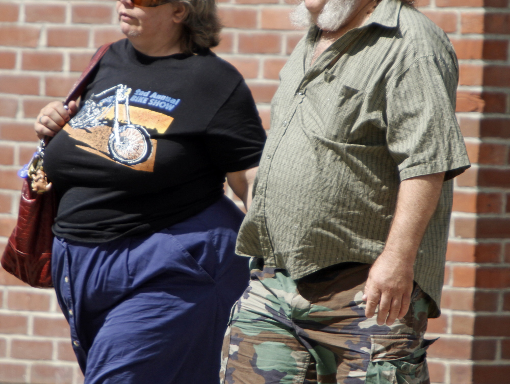 A study shows obesity in middle age is linked to earlier development of Alzheimer's disease, researchers at the National Institutes of Health said Tuesday.