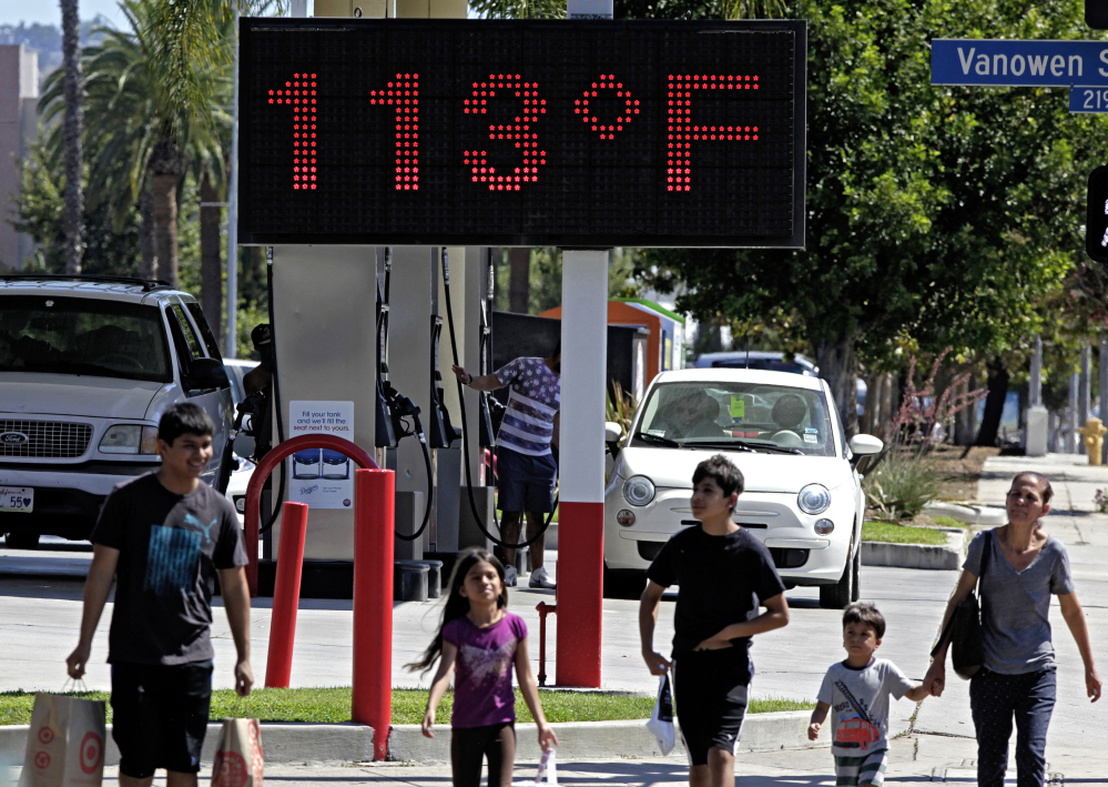 A warm day in Los Angeles in August 2015 clocks in at 113 degrees on a road-side thermometer. Government scientists say 2015 was a record year.