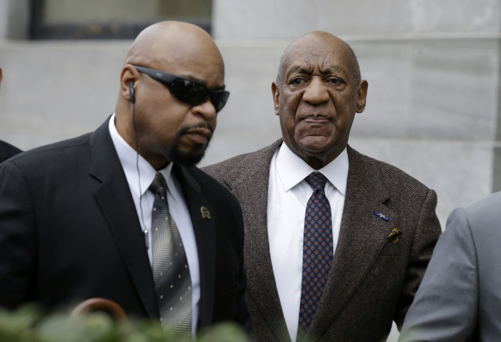 Bill Cosby arrives for his court appearance Wednesday in Norristown, Pa. A judge rejected Cosby's defense team's motion to dismiss a sexual assault case against him over an unwritten promise of immunity that a former prosecutor says he gave Cosby's now-deceased lawyer.