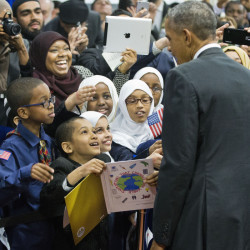 President Barack Obama stops to greet children from Al-Rahmah school and other guests during his visit to the Islamic Society of Baltimore on Wednesday in Baltimore, Md.