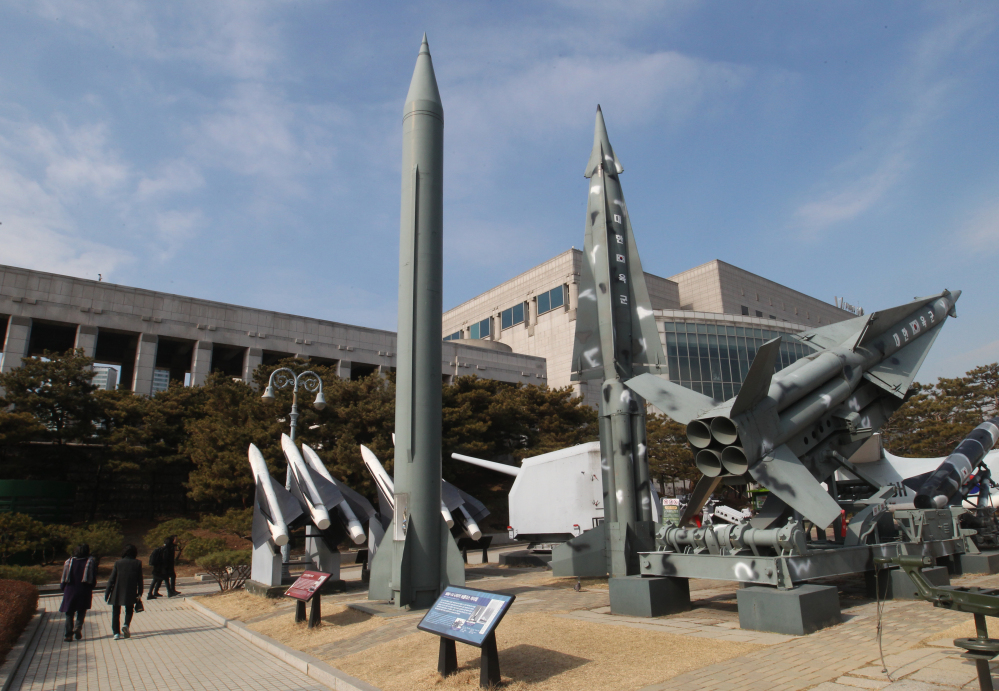 """A mock Scud-B missile of North Korea, left, and other South Korean missiles are displayed at the Korea War Memorial Museum in Seoul, South Korea, which on Wednesday warned of """"searing"""" consequences if North Korea doesn't abandon plans to launch a long-range rocket that critics call a banned test of ballistic missile technology."""