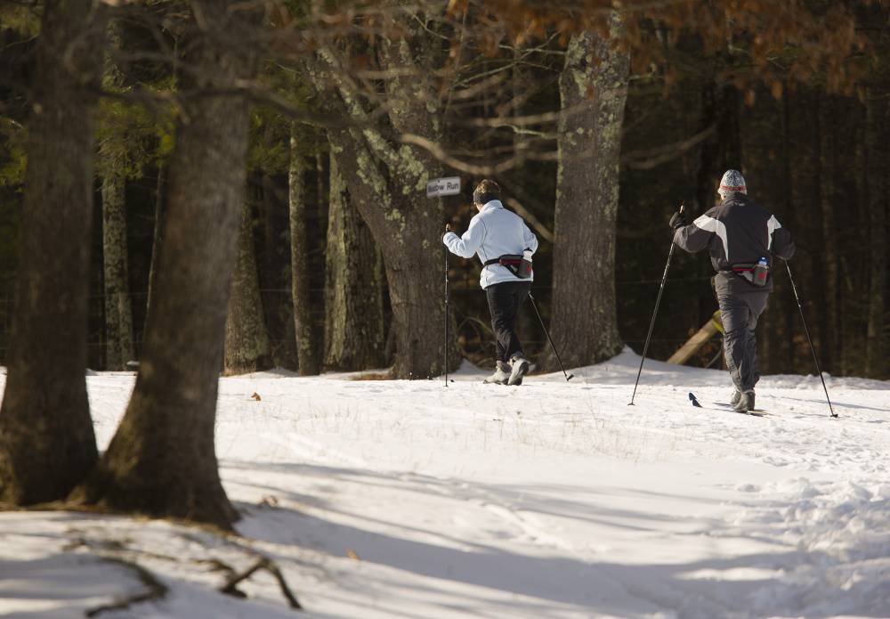 Jane and Rich Lisauskas of Kennebunk cross-country ski along the Buzzell Trail at Harris Farm in Dayton on Jan. 26.