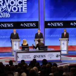 Republican presidential candidates Sen. Marco Rubio, R-Fla., left, and New Jersey Gov. Chris Christie, right, spar as businessman Donald Trump, Sen. Ted Cruz, R-Texas, and retired neurosurgeon Ben Carson listen during a Republican presidential primary debate hosted by ABC News at the St. Anselm College on Saturday in Manchester, N.H.