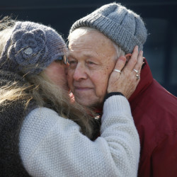 Chester Pettengill of Cliff Island gets a kiss from his cousin Kimberly Clark Stanhope of Brownfield during his 80th birthday celebration Saturday.