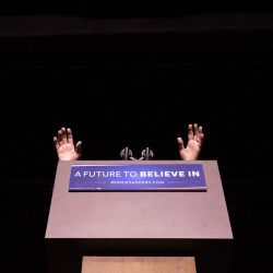 "The hands of Democratic presidential candidate Sen. Bernie Sanders of Vermont reach over the lectern during a rally at the Colonial Theatre in Keene, N.H. ""They're going to say he's not electable,"" said 75-year-old supporter John Jones of Sutton Mills, N.H. ""Well, that's (bull manure)."""